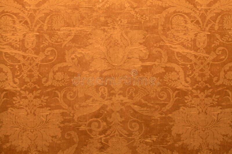 Papel de parede do vintage com teste padrão gasto da tapeçaria fotografia de stock