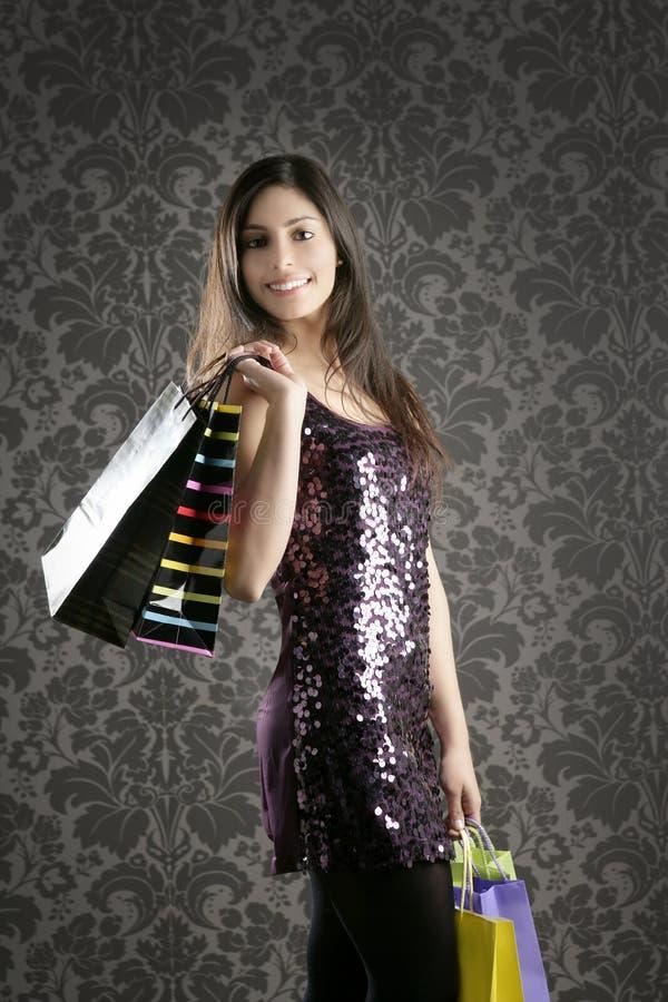 Papel de parede retro dos sacos coloridos da mulher de Shopaholic imagem de stock royalty free