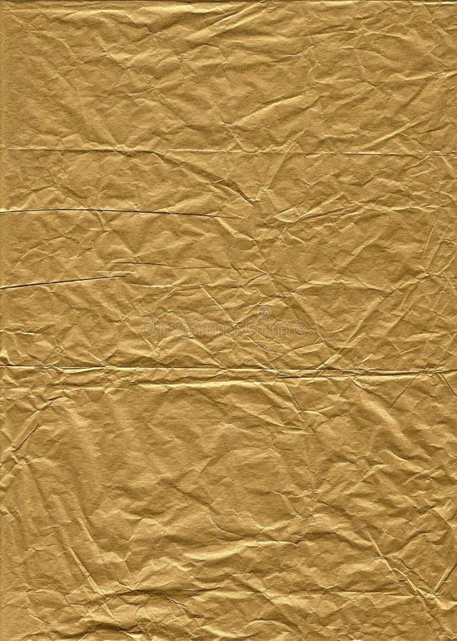 Papel de tecido enrugado do ouro fotografia de stock royalty free