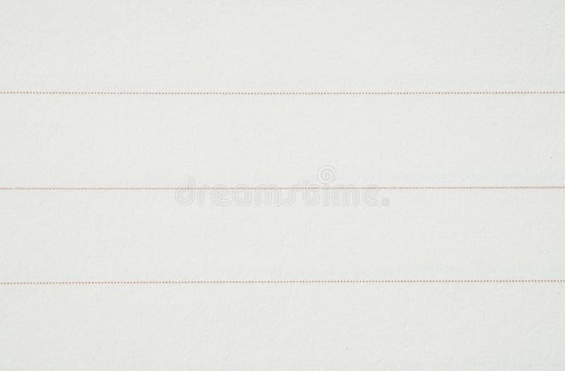 Papel do close up dentro do caderno com linha fundo da textura imagem de stock royalty free
