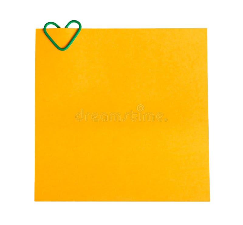 Papel do memorando e grampo sob a forma do coração foto de stock