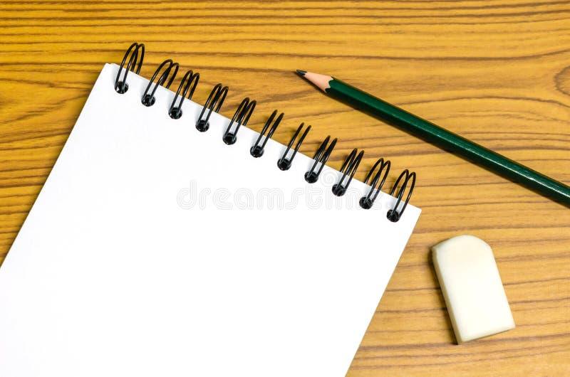 Papel, eliminador e lápis imagem de stock