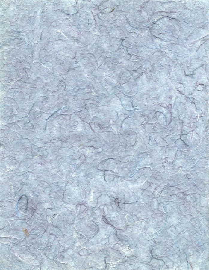 Papel hecho a mano con los hilos coloreados - aguamarina foto de archivo