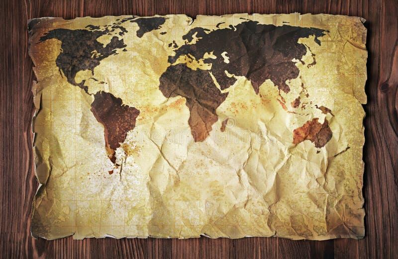 Papel manchado retro amarillo con el mapa viejo del vintage del mundo imagenes de archivo