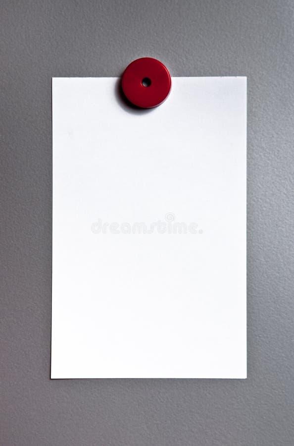 Papel na placa magnética foto de stock