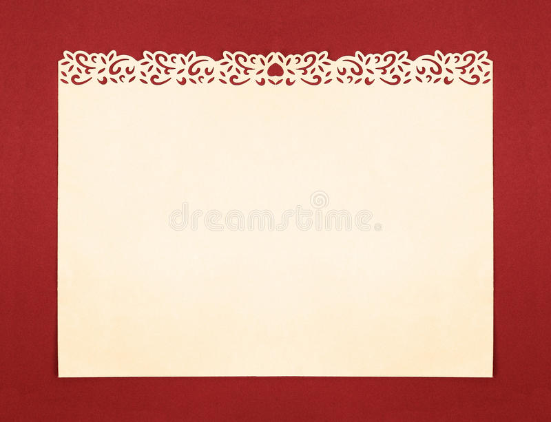 Papel poner crema con la frontera de lujo hecha a mano del recorte foto de archivo