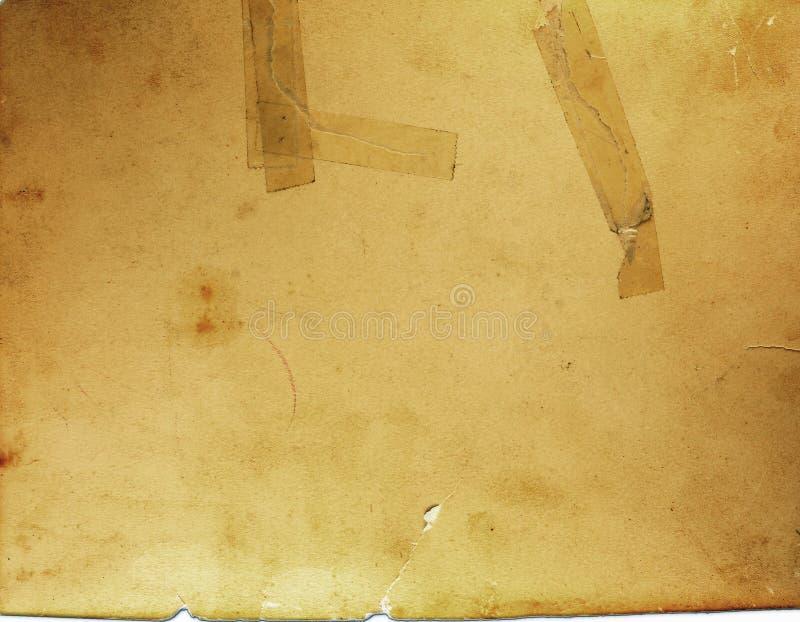 Papel quebradizo viejo con la cinta foto de archivo