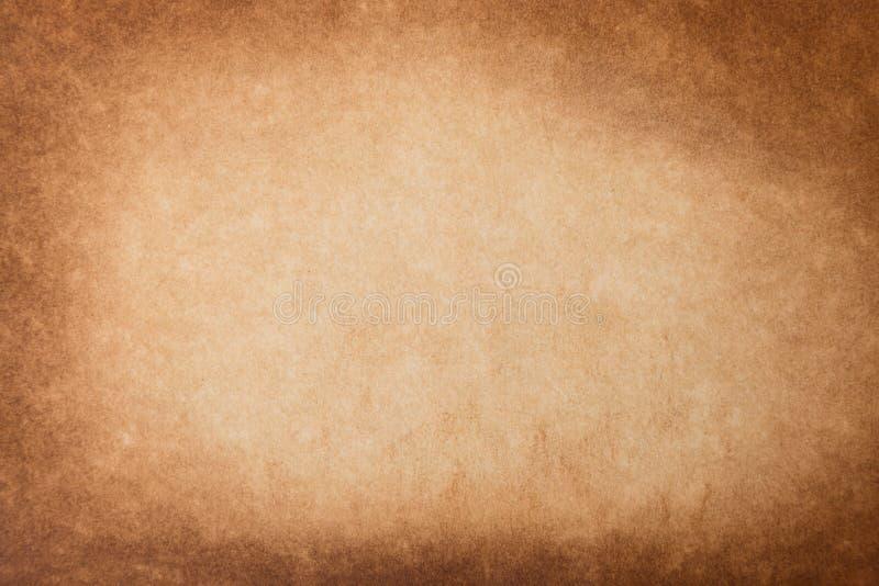 Papel velho da textura do fundo do grunge do vintage Brown queimou o fundo de papel imagem de stock