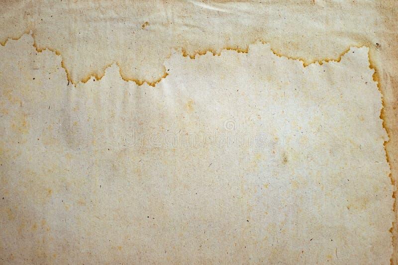 Papel viejo con las manchas del agua fotos de archivo