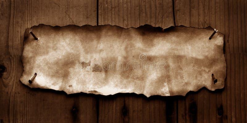 Papel viejo con los bordes quemados foto de archivo