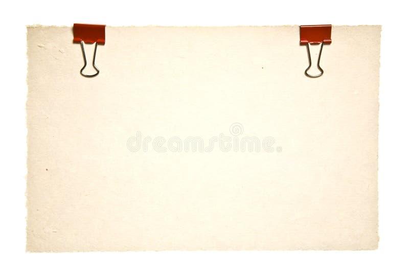 Papel viejo con los clips rojos foto de archivo libre de regalías