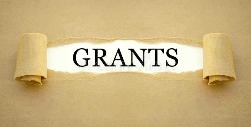 Papeleo con la concesión del gobierno para financiar la creación de una nueva empresa fotos de archivo libres de regalías