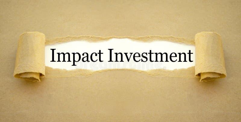 Papeleo con la inversión del impacto imagen de archivo