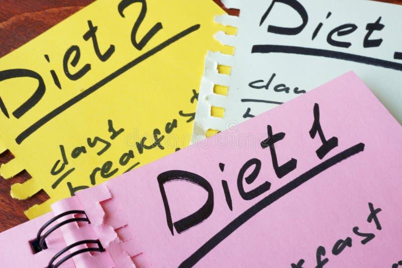 Papeles con dietas fotos de archivo