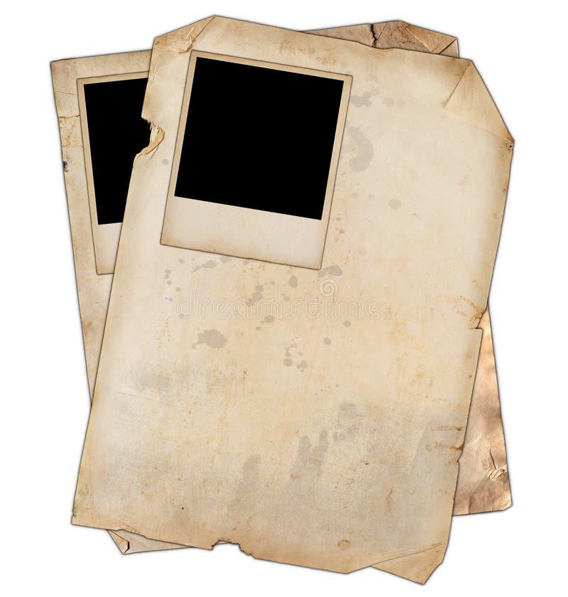 Papeles viejos con las fotos foto de archivo