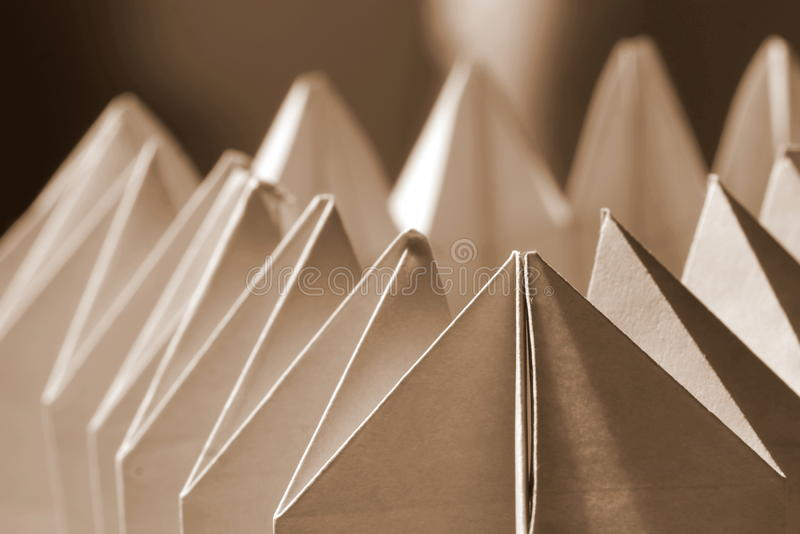 Paper abstract. Sharpened ends of a folded paper form close-up stock images