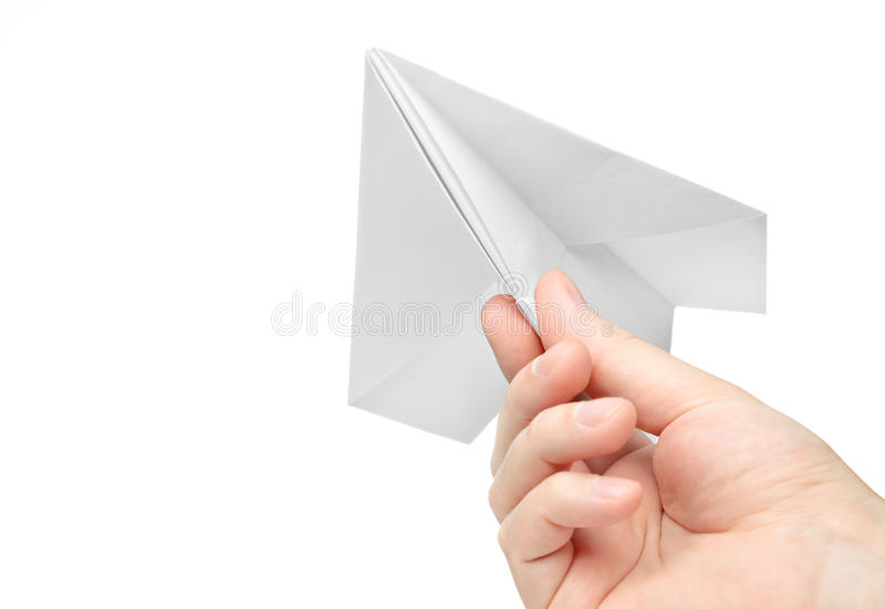 Paper airplane. Hand launches paper airplane on white background royalty free stock images