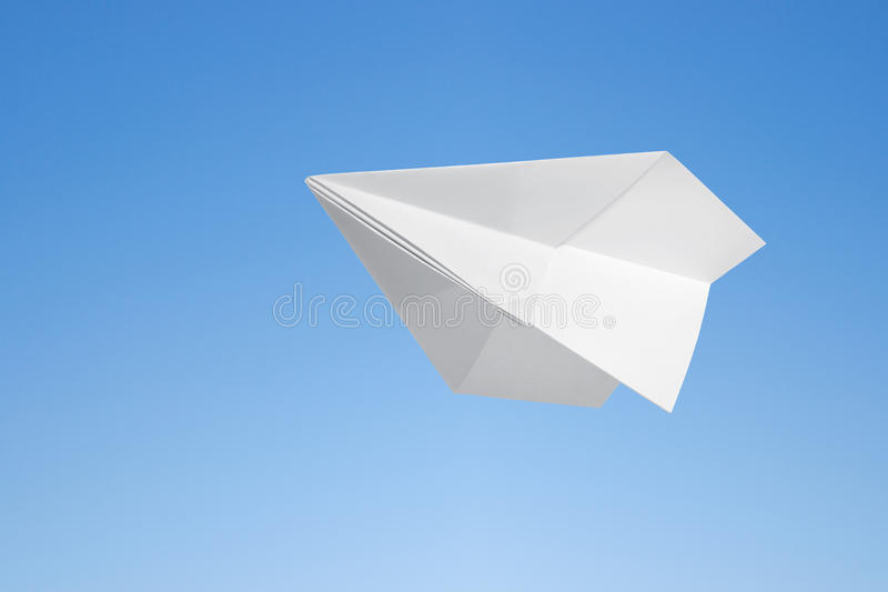 Paper airplane. Against the blue sky royalty free stock image