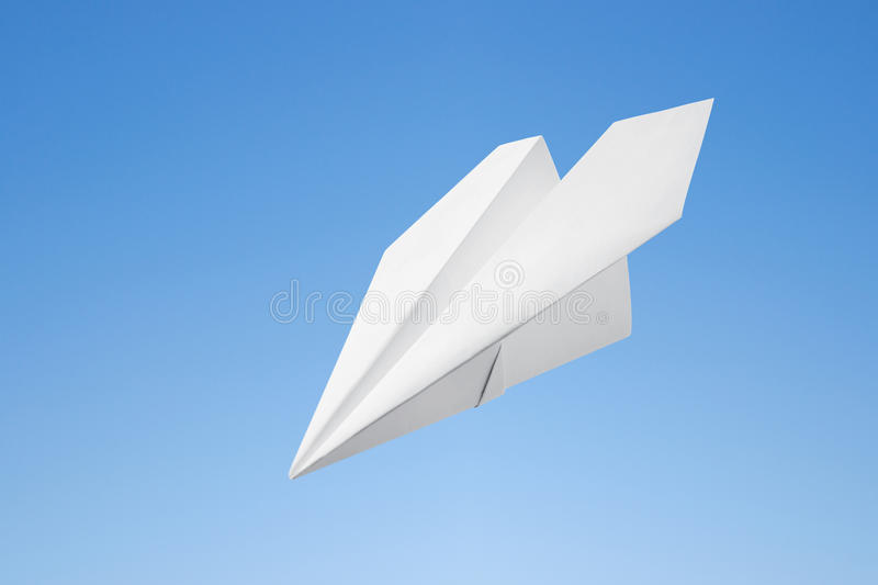 Paper airplane. Against the blue sky royalty free stock photography