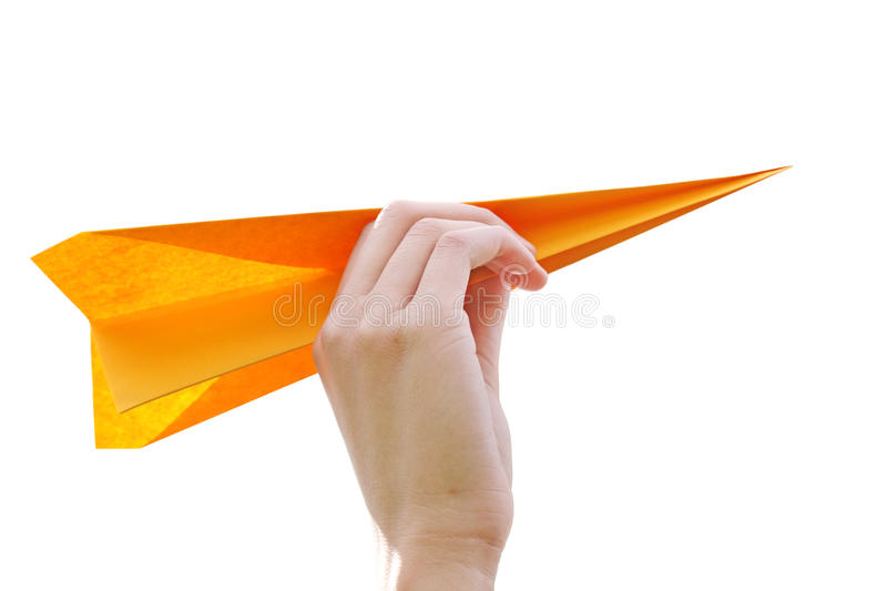 Paper Airplane. Hand launching paper airplane isolated on white royalty free stock photography