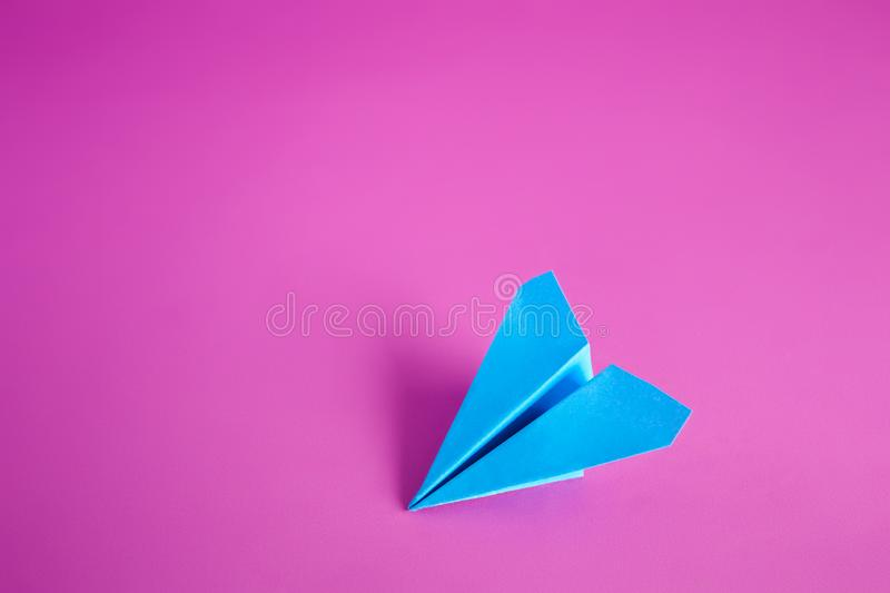 Paper airplane. Blue paper airplane on a purple background background royalty free stock images