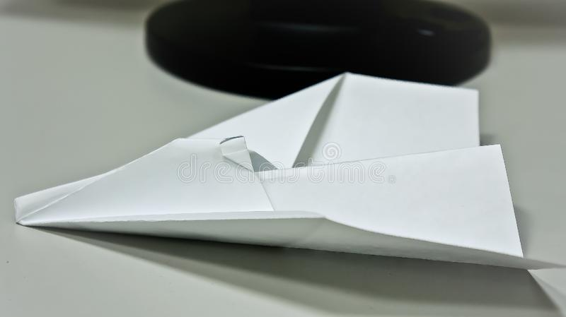 Paper airplane on the table stock images