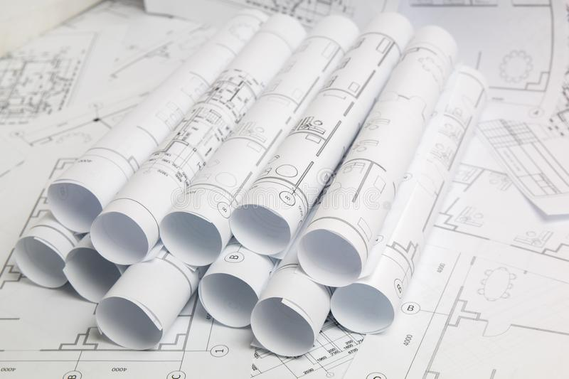 Paper architectural drawings and blueprint. Engineering blueprint stock images