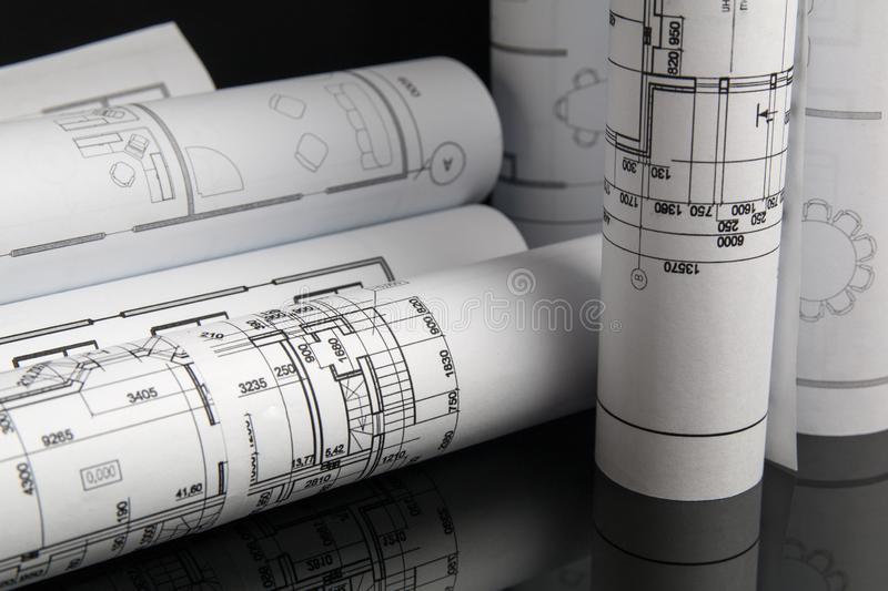 Paper architectural drawings and blueprint. Engineering blueprint royalty free stock images