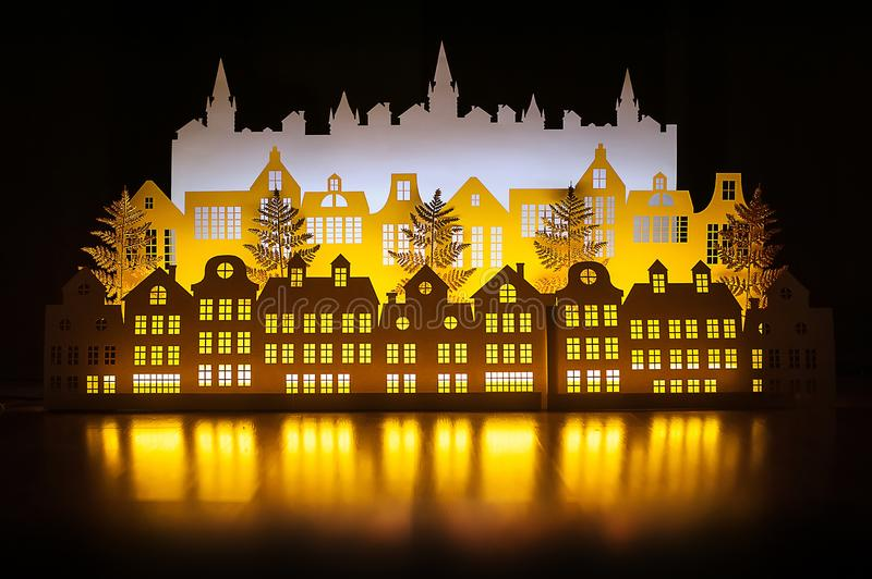Paper art Night Winter Gold Town with New Year Lights. Happy new year and Merry christmas. Copy space for text stock photography