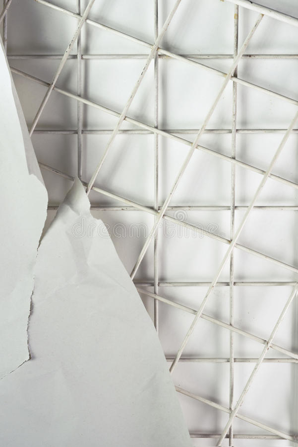 Paper backgrounds. Backgrounds of texture crumpled and riven paper on metal mesh stock photography