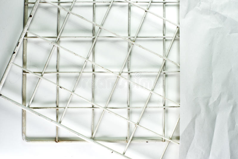 Paper backgrounds. Backgrounds of texture crumpled and riven paper on metal mesh stock image