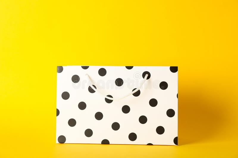 Paper bag on color background royalty free stock photo