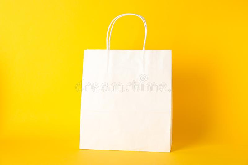 Paper bag on color background royalty free stock images