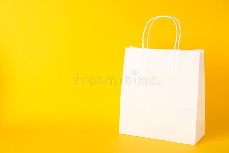 Paper bag on color background stock images