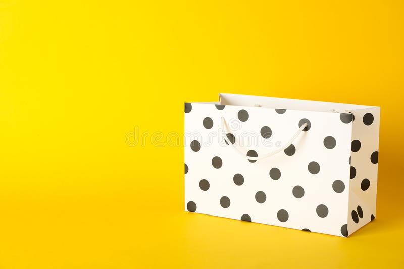 Paper bag on color background stock photo