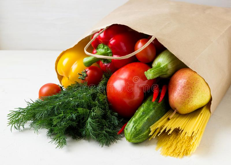 A paper bag with fresh vegetables and fruit. stock photography