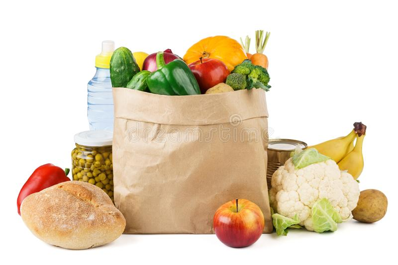 Paper bag full of fresh fruits and vegetables royalty free stock photography