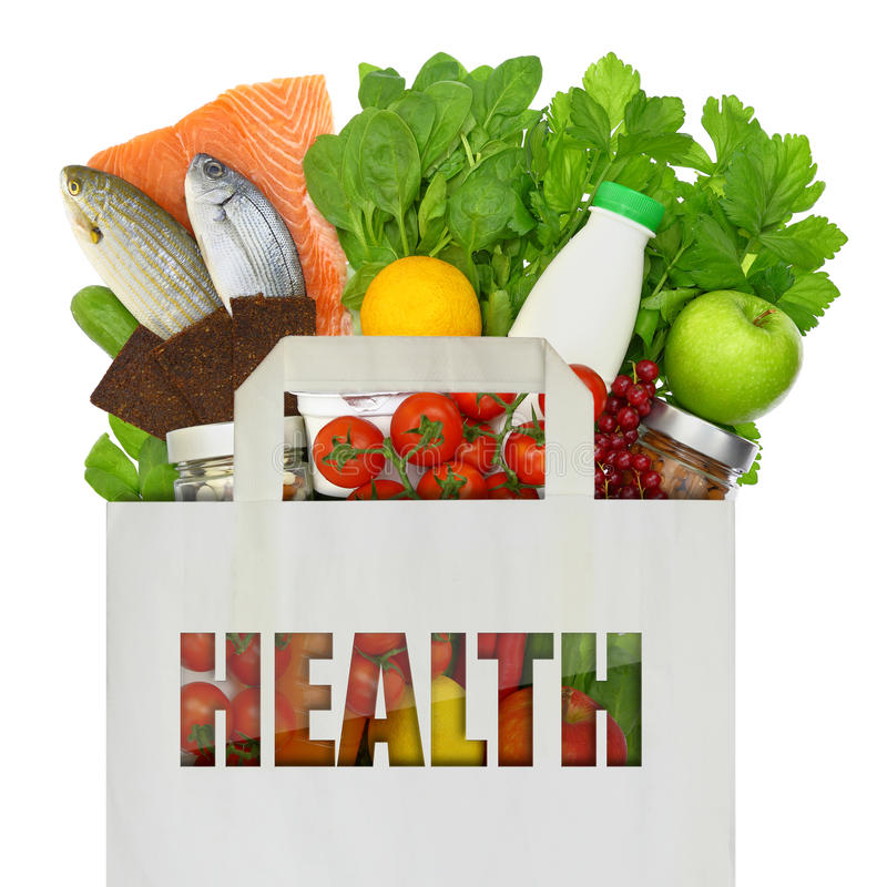 Paper bag full of healthy foods royalty free stock photos