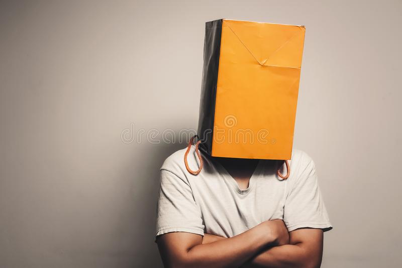 Paper bag on the head royalty free stock photo