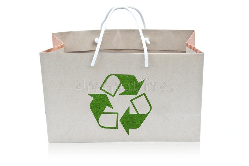 Paper bag with recycle sign. As white isolate background stock photography