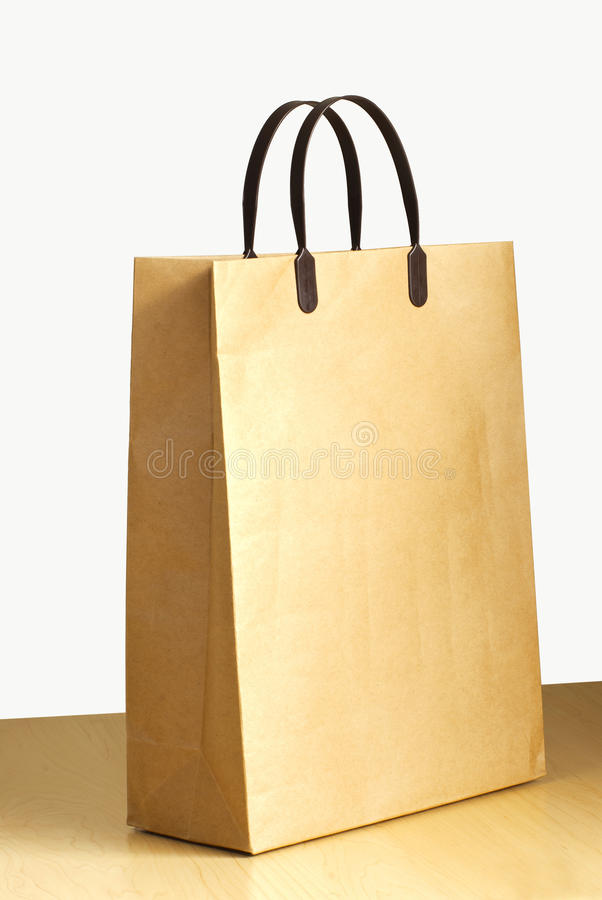 Paper bag on wooden floor