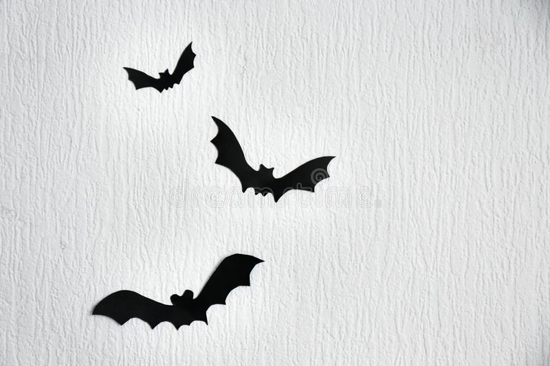 Paper bats as decor for Halloween party on wall royalty free stock photography