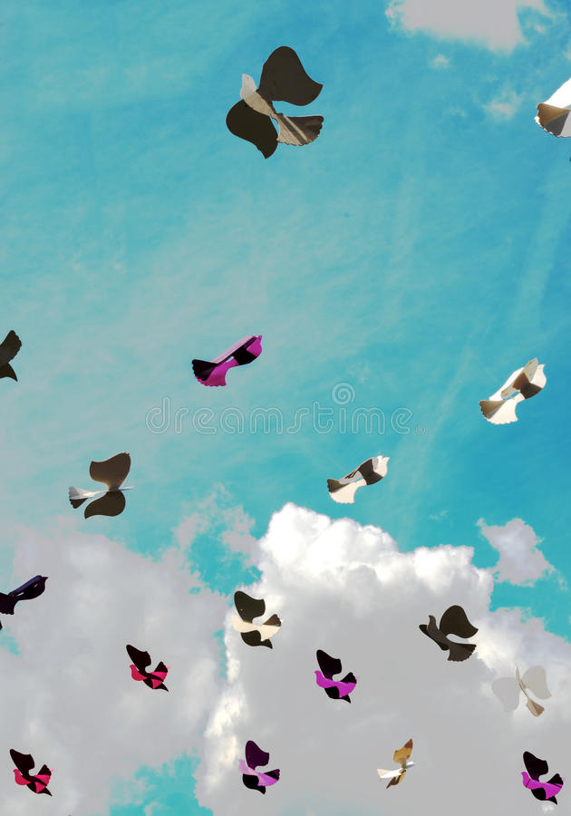 Paper bird in the sky with clouds royalty free stock photography