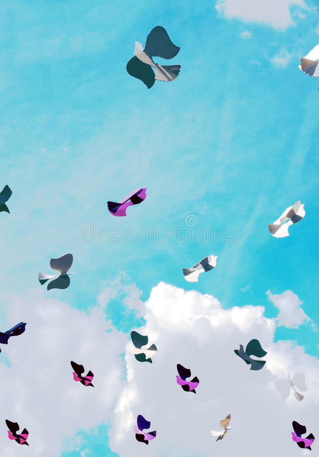 Paper bird in the sky with clouds royalty free stock photo