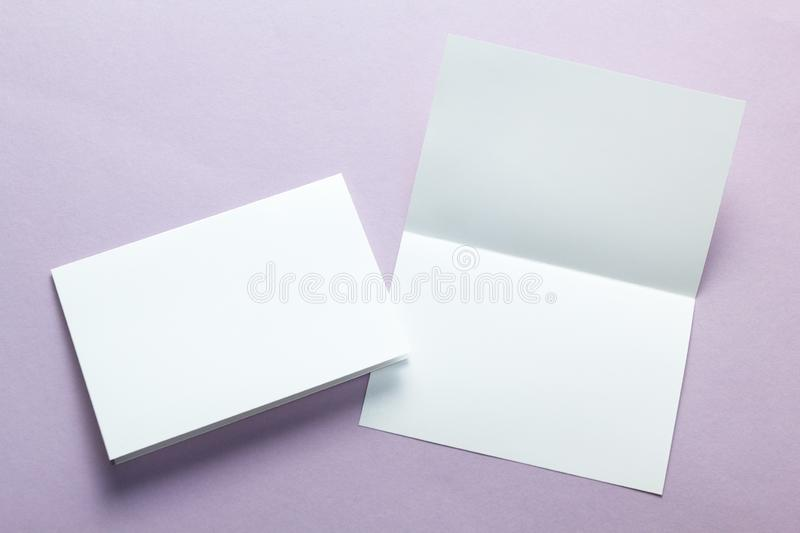 Paper blank business cards, brochures, flyers on a purple background. Mock-up.  royalty free stock photos