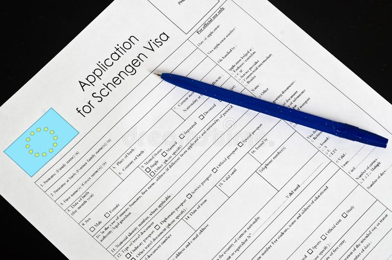 Paper blank form Schengen visa with a fountain pen stock image