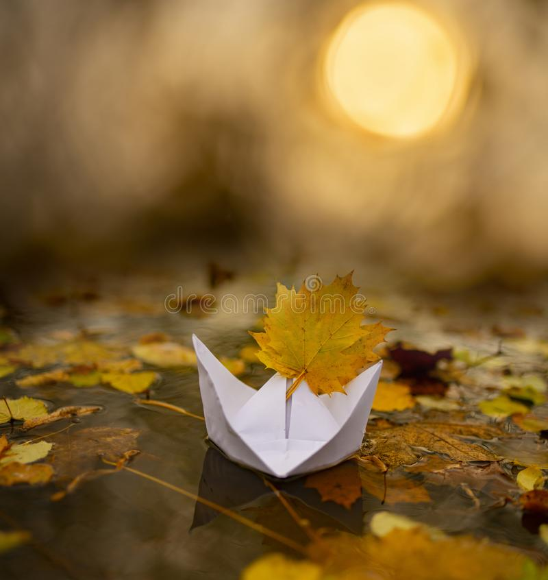 Paper boat on an autumn river royalty free stock photos