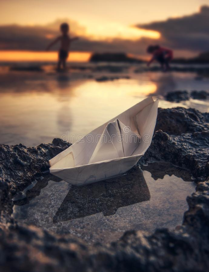 Paper boat - Children`s play royalty free stock photo