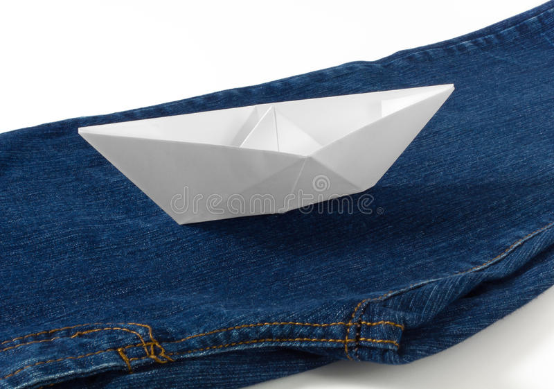 Download Paper Boat on Blue Jeans stock photo. Image of folding - 29817308