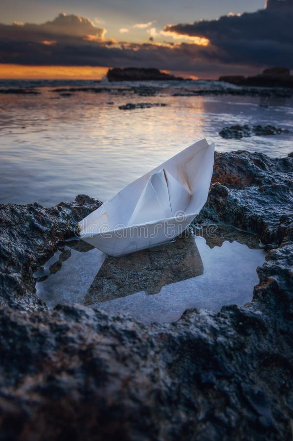 Paper boat on shore stock images